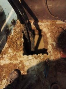 Located drill head under concrete floor